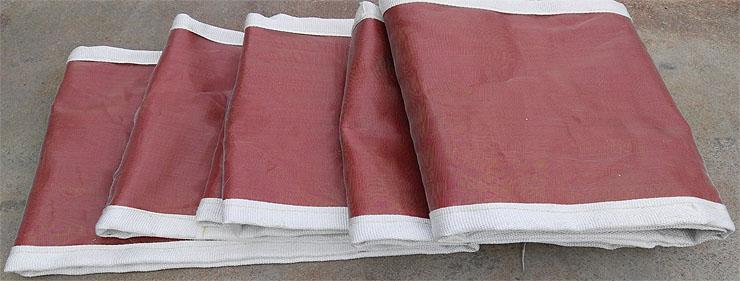 Non-metallic compensator skin