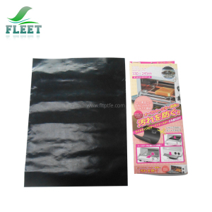 Black Teflon Cooking Liner Used as Outdoor BBQ Tool